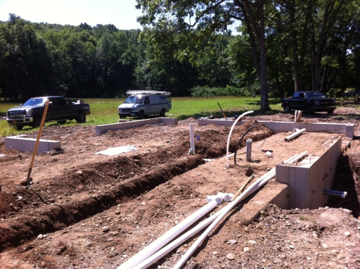 Laying the plumbing pipes underneath where the slab will be poured